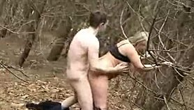 Showing her big natural titsin the woods